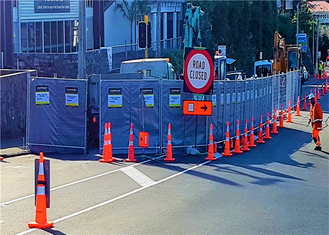Construction Site Portable Sound Barrier Secured with Temp Fence Panels supplier